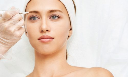 Permanent makeup. Beauty spa procedure. young woman. Face tattoo. Eyeliner micropigmentation. Professional face microblading. Female cosmetology device. Facial treatment. Dermatology